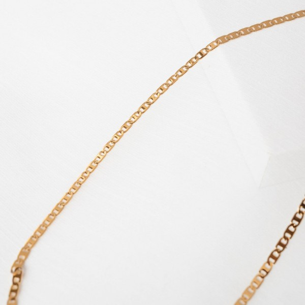 Thin gold chain necklace detail